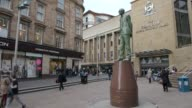 Long shot of statue of Donald Dewar Shopping On Glasgow High Street on April 24 2013 in Glasgow Scotland Long shot of statue of Donald Dewar Shopping...