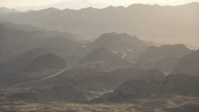 Long Shot Of The Hoover Dam Through The Haze And Sunset