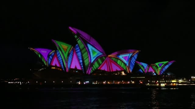 Long shot of the Sydney Opera House illuminated Vivid Sydney Opening Night on May 24 2013 in Sydney Australia