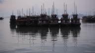 Long shot of tourist boat moored at Halong Bay, Vietnam.