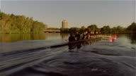 Long shot past crew team rowing racing shell on Charles River