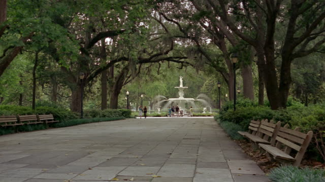 Long shot paved mall leading to fountain in Forsyth Park / Savannah, Georgia