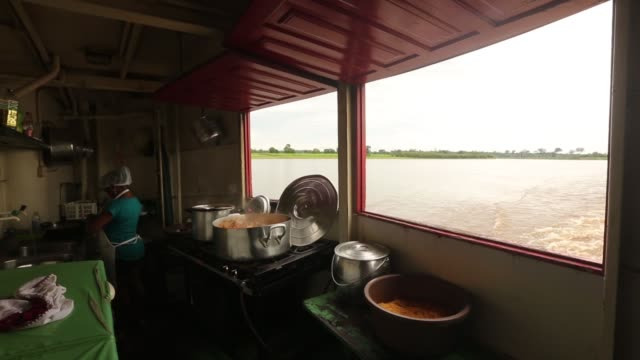 Long Shot riverboat kitchen during meal preparation A transport riverboat travels in the Brazilian Amazon from Maues to Manaus on November 27 2013 in...