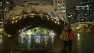 Long Shot snow collects on Anish Kapoor's Cloud Gate in Millennium Park on November 11 2013 in Chicago Illinois The snowfall was the first of the...