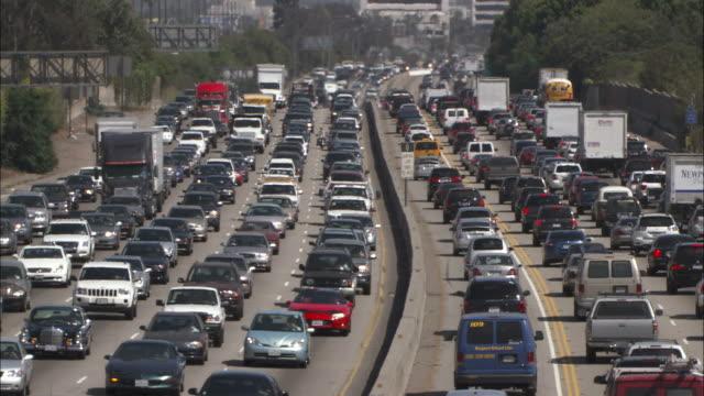 Long Shot static - Heavy traffic drives along a ten lane highway