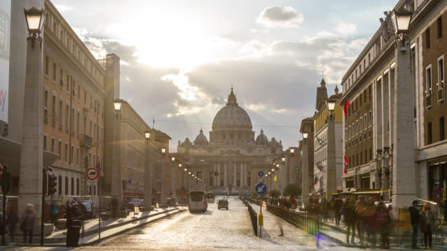 Long shot timelpse of Saint Peter's basilica Dome at sunset with car traffic. Vatican, Rome, Italy. April, 2016.