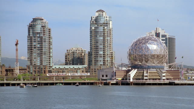 Long shot view of Science World and skyscrapers on waterfront / Vancouver