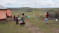 Long Shot Xhosa women sing and dance as young men take part in a manhood ceremony in Qunu ahead of the funeral of Nelson Mandela on December 13 2013...