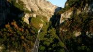 Long straight Road Through Mountains
