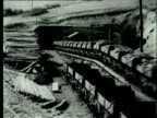 1927 B/W WS Long train of coal mine carts laden with bituminous coal emerging from underground coal mine/ Pennsylvania, USA
