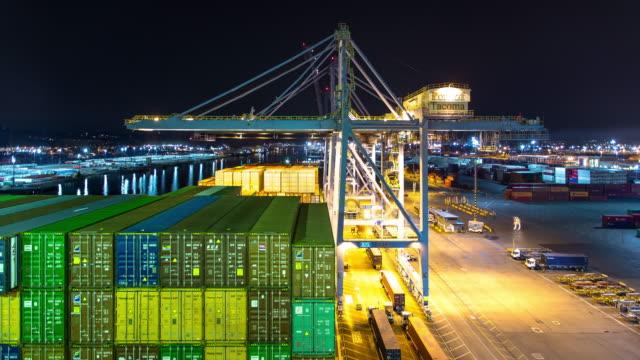 Longshoremen Unloading Ship at Night