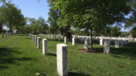 Looking along rows of grave markers in Arlington National Cemetery. Shot in May 2012.