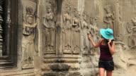 Looking at Angkor Wat apsaras