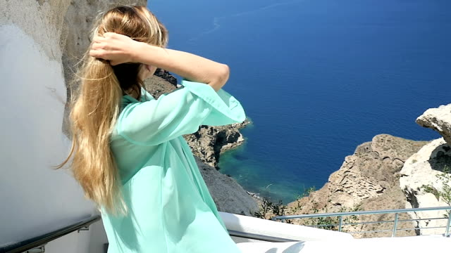 Looking at sea view & tossing her hair