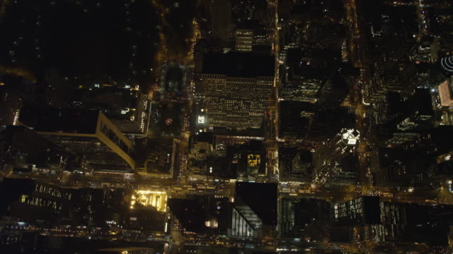 Looking down on streets and skyscrapers of Midtown Manhattan at night, Central Park coming into view at left. Shot in November 2011.