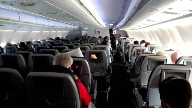 Looking forward through a Qatar Airways aircraft cabin from a rear seat row 4K resolution