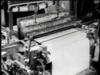 1921 MONTAGE Loom refining asbestos and workers operating machines in large room / Waukegan, Illinois, United States