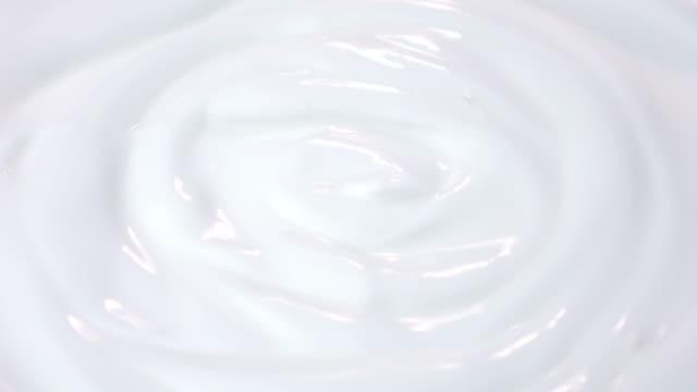 Loopable video of swirling yogurt in 4K