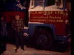 Lorry drivers action FRANCE Night Cluses CMS British lorry PAN RL to back of parked lorry as two Drivers stand MCRAE and BARRY BRADSHAW British Lorry...