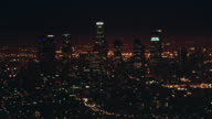 AERIAL Los Angeles city skyline at night / California, United States