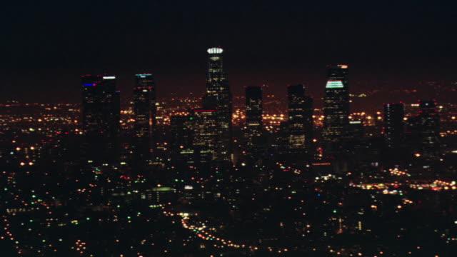 AERIAL Los Angeles city skyline at night / California, United States