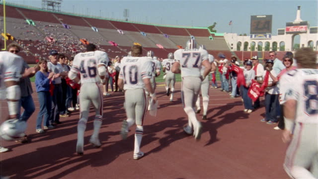 1985 MS Los Angeles Express entering field at beginning of game against Tampa Bay Bandits/ USA
