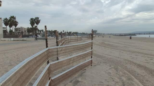 (HD1080i) Los Angeles: Fence on Santa Monica, Venice Beach Sand