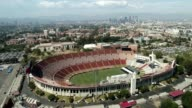 Los Angeles Memorial Coliseum - trucking shot with LA city in background