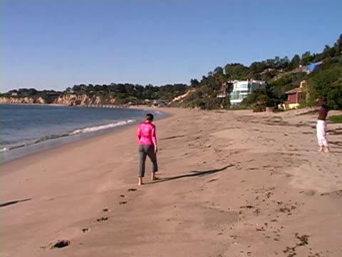 Los Angeles: Woman Walks on Malibu Beach