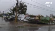 Los habitantes de la zona oriental de Republica Dominicana recogian parte de los destrozos causados por el paso del Huracan Maria que aunque...