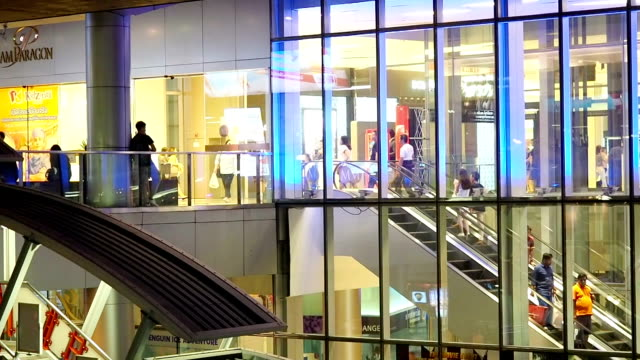 Lots of customers walking in the shopping mall