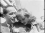 Louis Bromfield Lauren Bacall and Humphrey Bogart walking on farm / Bromfield points to something in the distance / Bacall Bogart and Bromfield...