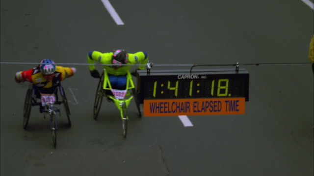 Louise Sauvage and Jean Driscoll race to finish line of Women's Wheelchair race, Boston, Massachusetts, 1997 Available in HD.