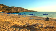 Lounge chairs and umbrellas on beach Potali on Karpathos island