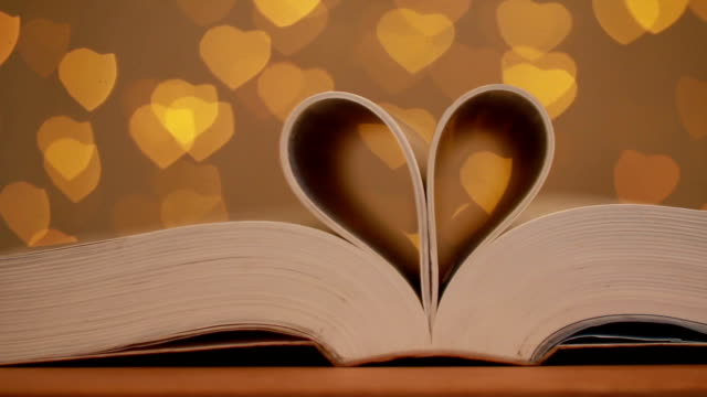 love story, page made heart shape with heart facula background