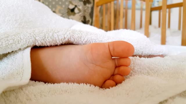 Lovely little foot of sleeping baby