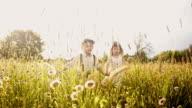 SLO MO Loving boy and girl walking through high grass