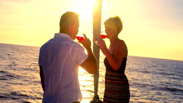 MS Loving Couple Drinking Wine On A Sailboat