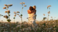 HD SLOW-MOTION: Loving Couple In Buckwheat Field