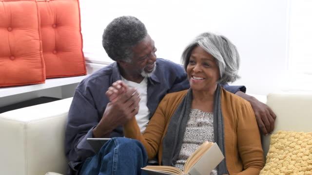 Loving senior African American couple on sofa