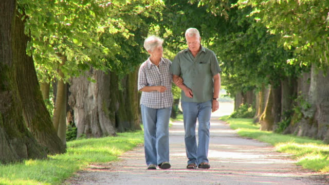 HD: Loving Senior Couple Walking In The Park