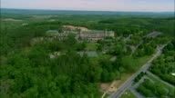 Low altitude aerial orbiting shot of the Hershey Hotel and Hershey Gardens at Hershey, PA