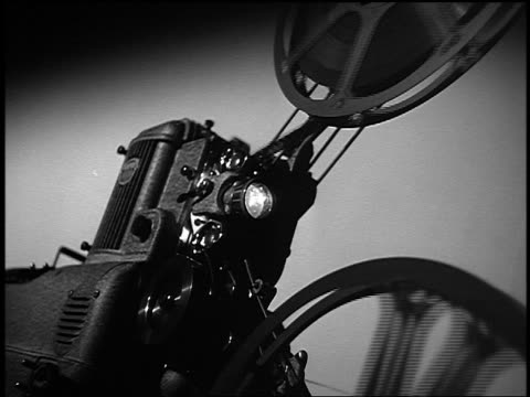 B/W low angle close up 16mm film projector running
