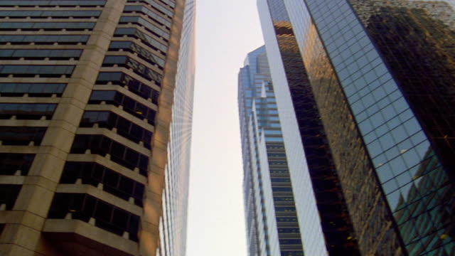 Low angle close up pan two modern skyscrapers (PNC Bank and Centre Square) / Philadelphia, Pennsylvania