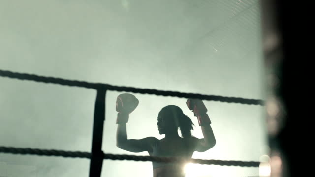 Low Angle MS Female Boxer Victorious.