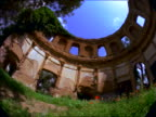 low angle FISHEYE PAN ancient ruins of stadium / Hadrian's Villa outside of Rome