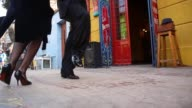 Low Angle Long Shot Dancers perform a Tango at La Boca on September 11 2013 in Buenos Aires Argentina