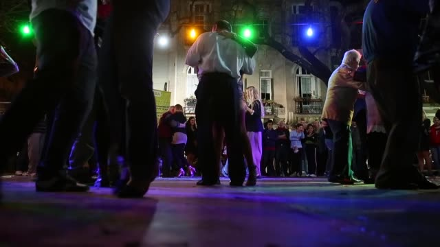 Low Angle Long Shot Dancers perform a Tango at Plaza Dorrego in San Telmo on September 8 2013 in Buenos Aires Argentina
