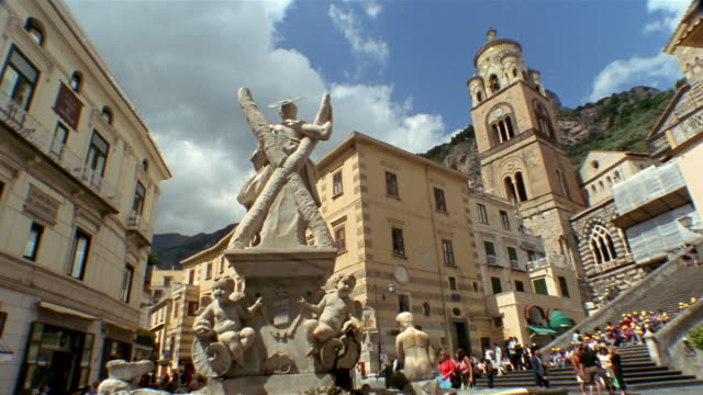 Low angle long shot rear view of Fontana di Sant'Andrea in the Piazza Duomo in Amalfi / Italy