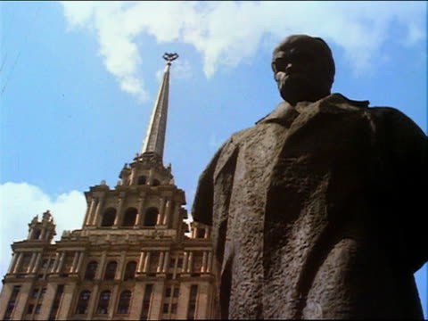 1967 low angle long shot statue of poet Taras Shevchenko standing in front of the Hotel Ukraina / Moscow